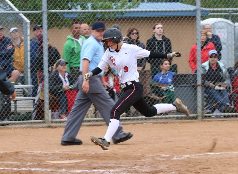 REVIEW/NEWS PHOTO: JIM BESEDA - Oregon City's Emily Dugan scored to pull the Pioneers into a 1-1 tie with Westview in the fourth inning of Tuesday's OSAA Class 6A softball semfinal game.