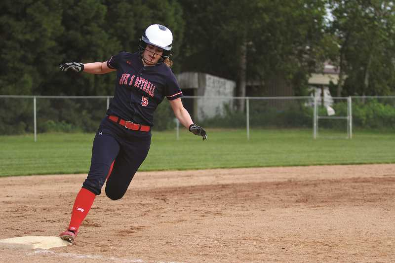 PHIL HAWKINS - Kennedy junior Hannah Arritola rounds third base to score on an RBI-double from teammate Tressa Riedman in the Trojans' two-run rally in the bottom of the sixth to make it a 3-2 game.