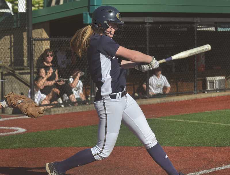 HERALD PHOTO: COREY BUCHANAN - Canby shortstop Cassidy Posey swings the bat during the Cougars first round loss to Jesuit Monday, May 22.