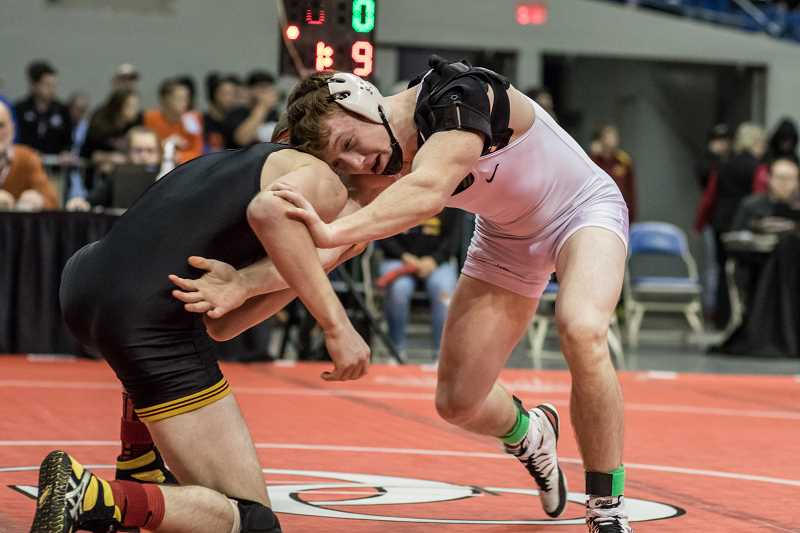 PAMPLIN MEDIA PHOTO - Hilhi's Peyton Bell wrestles during the OSAA State Championships at the Memorial Coliseum last winter.