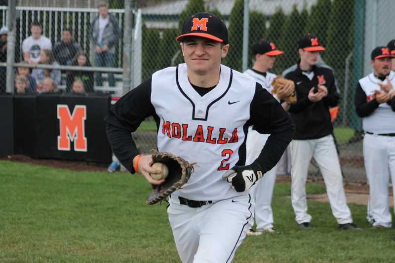 PIONEER PHOTO: CONNER WILLAMS  - Molalla senior Will Schaefer runs out to first base after his name is announced in the starting lineup during the Indians' senior night game against Crook County May 5.