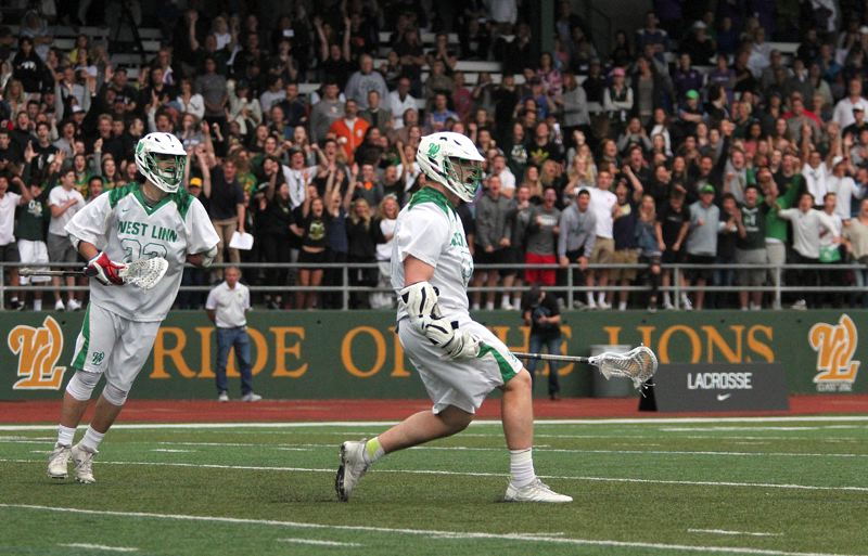 PMG PHOTO: MILES VANCE - West Linn's Mitchell Johnson (center) steps out to celebrate after he scored the game-tying goal at the end of the fourth quarter in his team's 11-10 overtime loss to Oregon Episcopal in the state semifinals at West Linn High School on Wednesday.