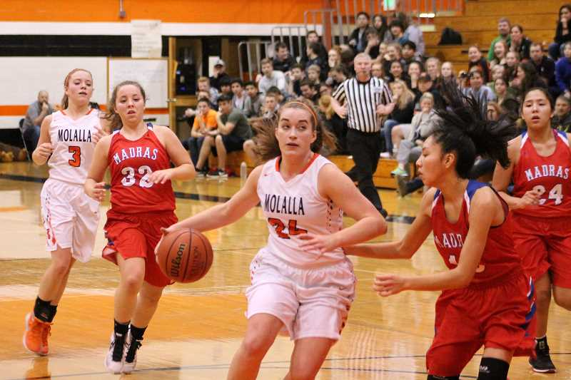 PIONEER PHOTO: CONNER WILLIAMS - Molalla senior Audrey Rieskamp pushes towards the basket during a game against Madras at home last season.