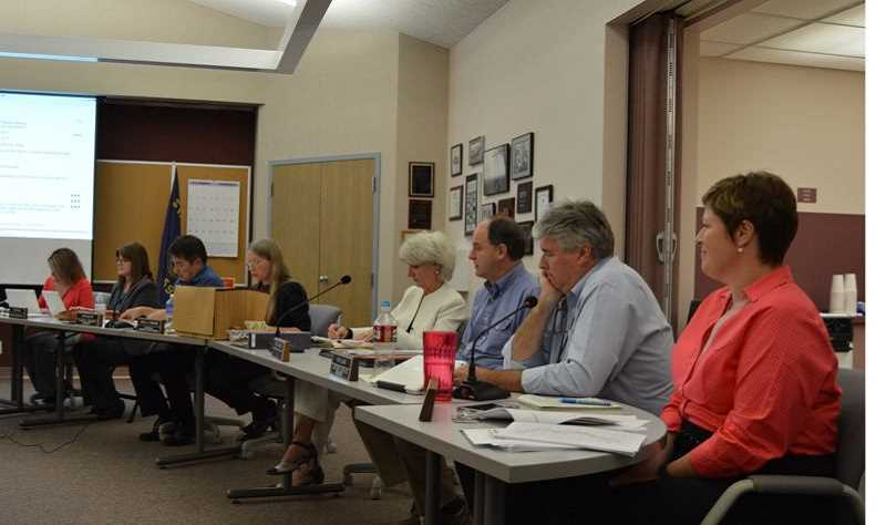 FILE PHOTO - Columbia River People's Utility District employees attend a 2015 board meeting. Four CRPUD managers were fired in September of that year. Pictured left to right: Former IT Manager Serena Brooks, Executive Assistant Heidi Ralls, Interim General Manager John Nguyen, former Customer Accounts and Accounting Manager Sheila Duehring, former Government Risk and Relations Manager Valarie Koss, former Engineering and Operations Manager Steve Hursh, Customer Services, Accounting and Energy Services Manager Rick Lugar and Communications Specialist Libby Calnon.