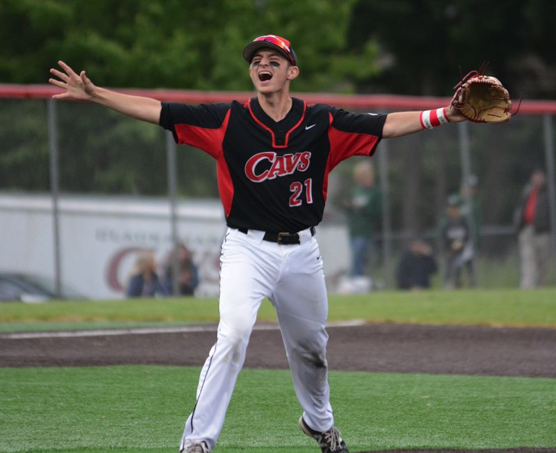 PMG PHOTO: DAVID BALL - Clackamas third baseman Greg Mehlhaff celebrates after making the final out during the Cavaliers' 6-2 win over Sheldon in its semifinal game.