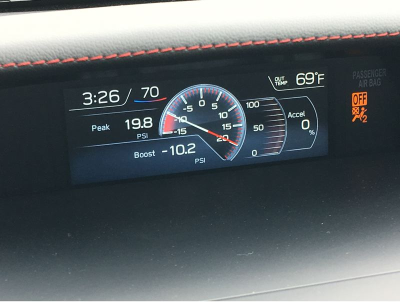 PORTLAND TRIBUNE: JEFF ZURSCHMEIDE - The engine data display mounted up high on the dashboard shows current boost or vacuum level in the engine and your rate of acceleration.