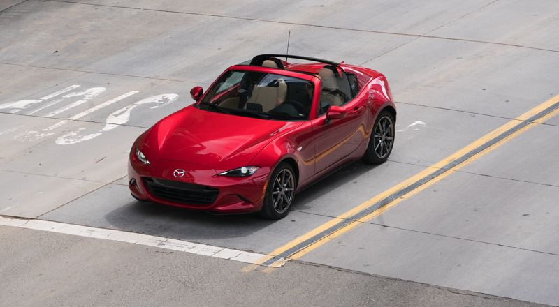 MAZDA USA - The center of the roof folds back into a storage space, giving it a targa top look when retracted.