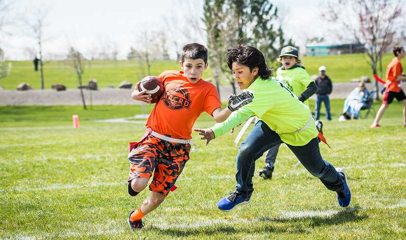 MARTY GOODSON/FOR THE PIONEER - One of the MAC and Rec. District's more popular youth sports programs is its fall and spring flag football league. This upcoming fall, tackle football will be introduced as a program for fifth and sixth graders.