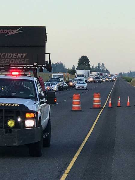 COURTESY OREGON STATE POLICE - Just one lane of Interstate 5 northbound remained open during rush hour this morning as investigaors tried to piece together what happened after a white box truck plowed into the workers' truck and then fled the scene.