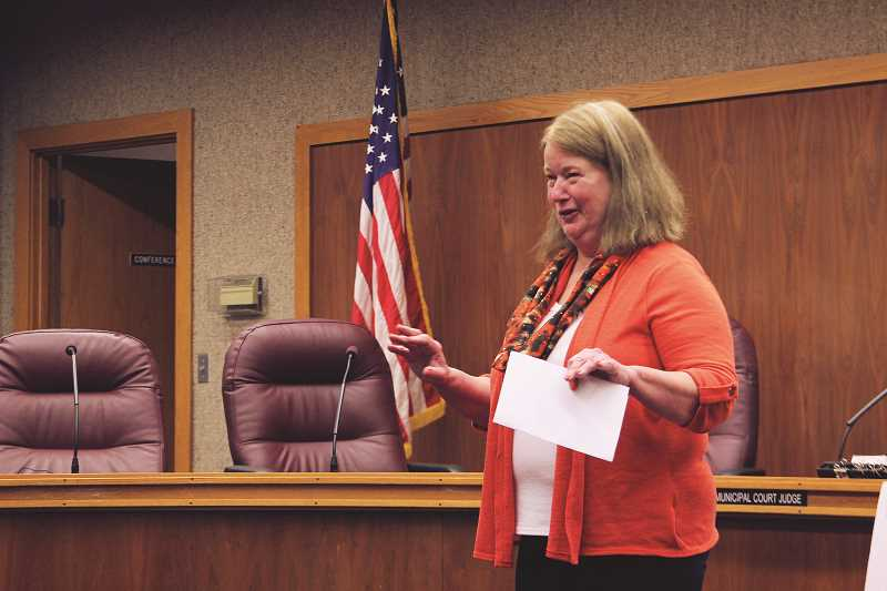 INDEPENDENT PHOTO: JULIA COMNES - Woodburn mayor Kathy Figley delivered her annual State of the City address in the City Council chambers on June 2. Much of the speech focused on the uptick in development expected in the city.