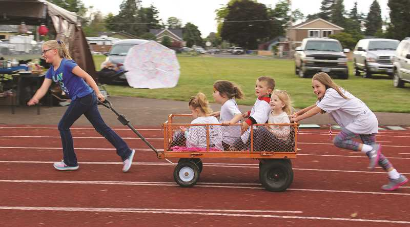 PEGGY SAVAGE - These youngsters went all out in Molalla's annual Relay for Life Saturday at Heckard Field. The track was filled with walkers — and in this case, runners — as Molalla-area people helped earn funding for Cancer research.