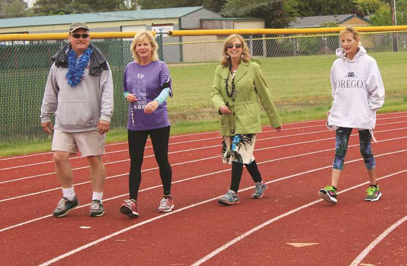 PEGGY SAVAGE - One of many Molalla-area teams on the track Saturday to help raise funds to fight cancer