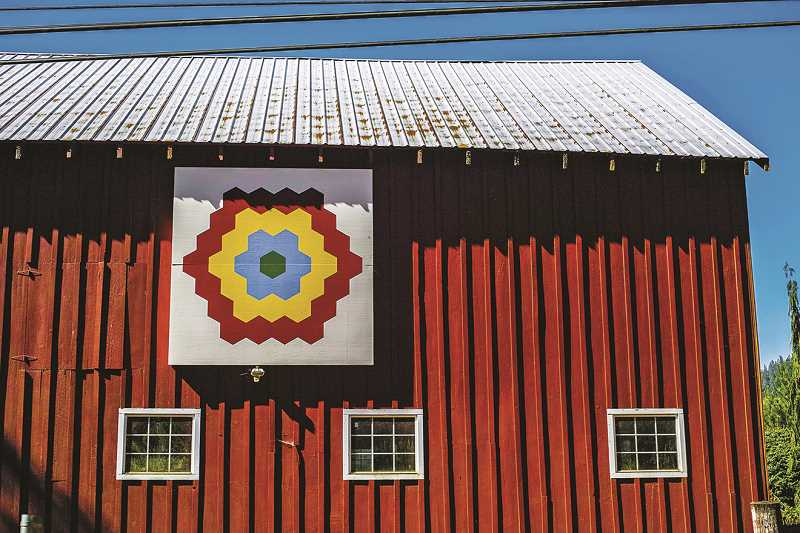 FILE PHOTO - Painted quilt blocks are now on 30 barns and buildings across the Tualatin Valley. Westside Quilters Guild recently was honored for its work on the Washington County Quilt Barn Trail.