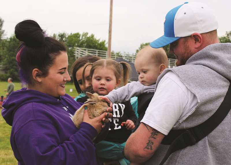 PEGGY SAVAGE - There's more to Relay for Life than making laps around the track -- these little ones check out a baby bunny in the infield
