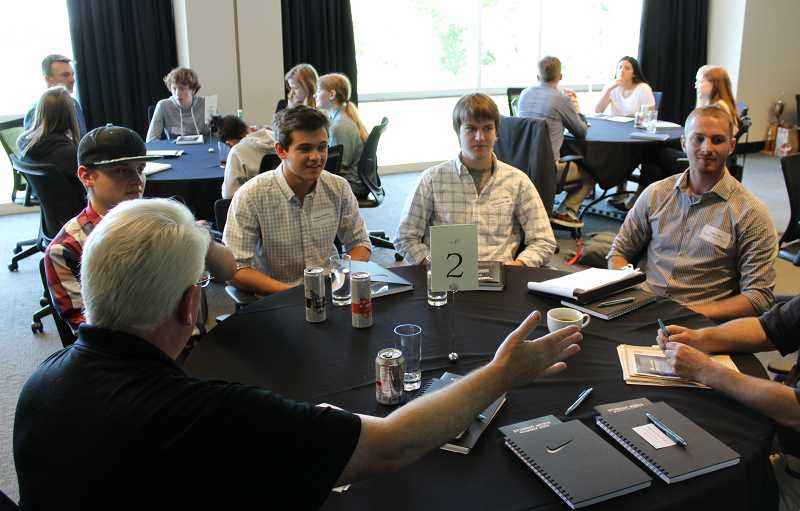 SPOKESMAN PHOTO: ANDREW KILSTROM - Pamplin Media Group Prep Sports Editor Miles Vance discusses interview techniques with Wilsonville Spokesman columnists Keaton Whittaker (middle left) and Jackson Shavere (middle right) at the May 31 Student Media Summit.