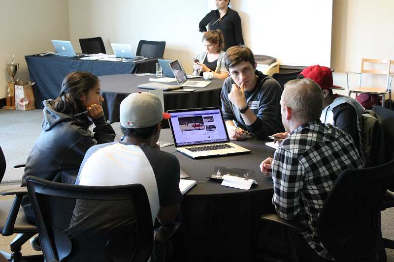 SPOKESMAN PHOTO: ANDREW KILSTROM - Student journalists learn from Portland Trail Blazers Digital Content Specialist Cody Sharrett at the Student Media Summit May 31.