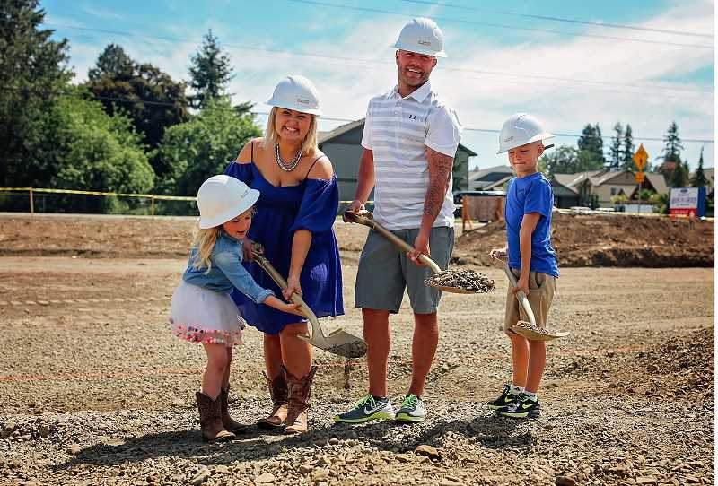 REBEKAH MUTCHLER , WELL LOVED PHOTOGRAPHY - Dr. Olesya Salathe helps her daughter dig up one of the first shovelfuls of dirt Friday, along with her young son and her husband
