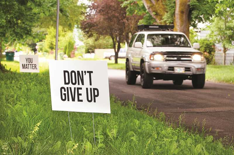 GARY ALLEN - Newberg residents Amy Wolff and Jessica Brittell have teamed up to produce and distribute signs with messages of encouragement like 'Don't give up' and 'Your mistakes don't define you' in response to the prevalence of suicide in the community.