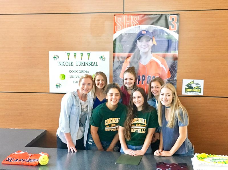 SPOTLIGHT PHOTO: JAKE MCNEAL - From left, Indians juniors Hannah Galey and Nicole Dougherty, senior Allyah Cates, sophomore Taylor Johnson, senior Nicole Lukinbeal, sophomore Peyton Fisher and junior Megan Dews celebrate Lukinbeal's commitment to Concordia University Irvine.