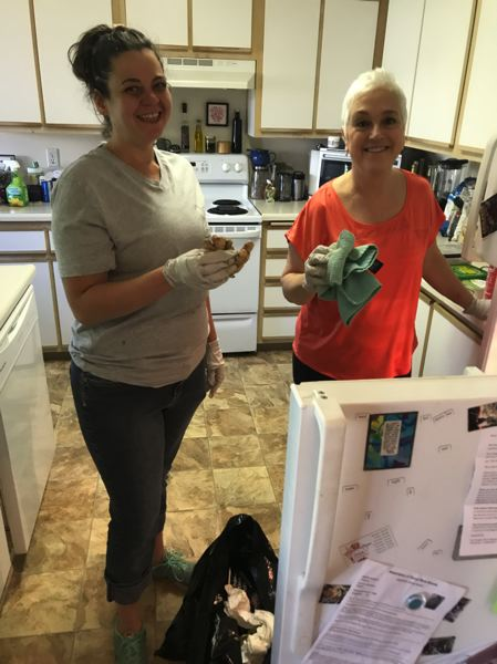 SUBMITTED PHOTO - Michelle's Love Board Members Miranda Barlow and Ellen Hatzi cleaning Shaw's kitchen.