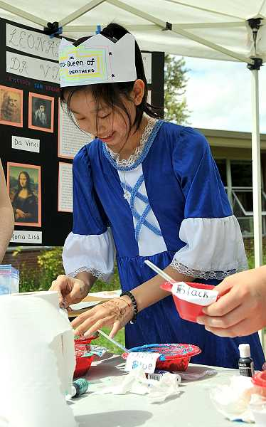 REVIEW PHOTO: VERN UYETAKE - Seventh-grader Emma Chang makes puffy paint during the Renaissance Faire.