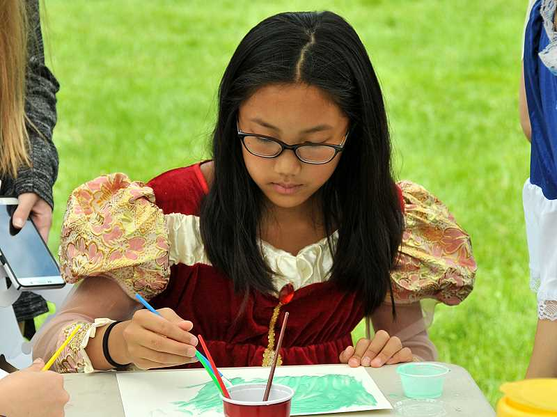 REVIEW PHOTO: VERN UYETAKE - Seventh-grader Katie Chi tries using puffy paint.
