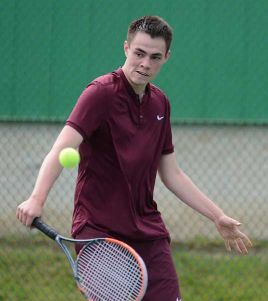 PAMPLIN MEDIA PHOTO - Forest Grove's Mitch Faris hits a shot during the past season's OSAA 6A State Tennis Championships. Viking girls varsity tennis coach TJ Buehler will be putting on a handful of tennis clinics this summer.