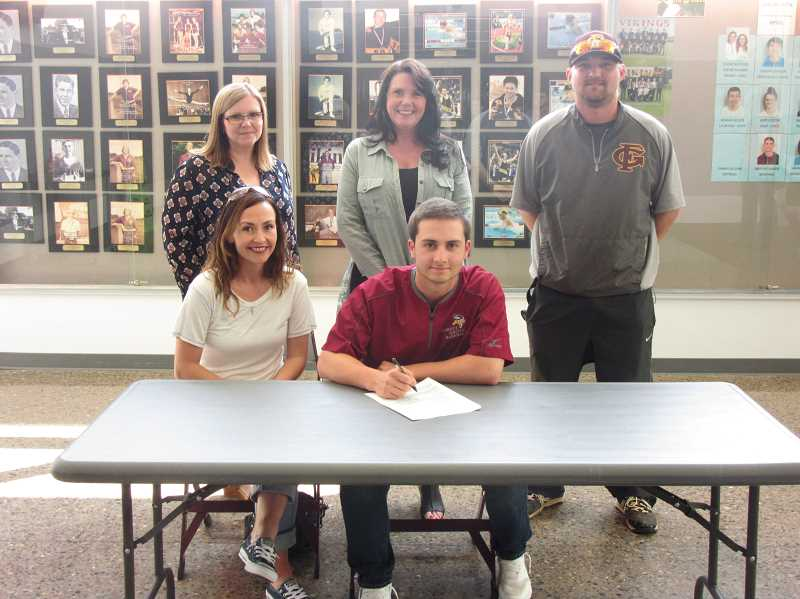 COURTESY PHOTO - Forest Grove's Tanner Heikes signs his letter of intent at Forest Groove High School in the presence of Principal Karen O'Neill, Assistant Principal Tami Erion, FGHS baseball coach Justin Engeseth and his mother Nicole.