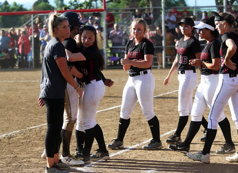 DAN BROOD - Tualatin players came out of the dugout to hug senior Sammi Caron following the final out of last week's state tournament semifinal game.