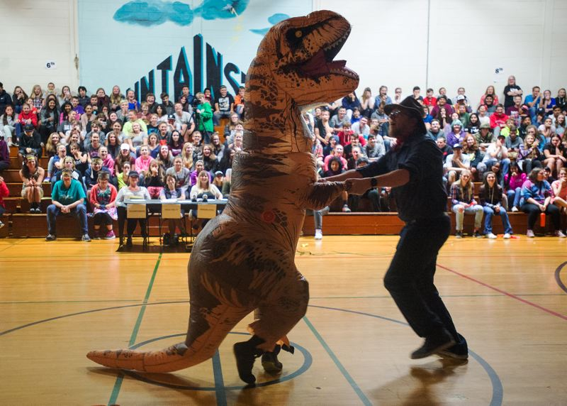 POST PHOTO: JOSH KULLA - Teachers Josh Kanable (in the T-rex suit) and Dennis Lane make their dance debut at Cedar Ridge.
