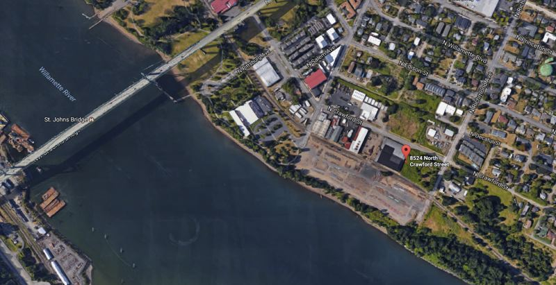 SOURCE: GOOGLE SATELLITE - The 15-acre site encompasses nearly eight city blocks, half of which are warehouses and the other have are empty train yards bordering the Willamette River, where the original St. Johns ferry was operated.