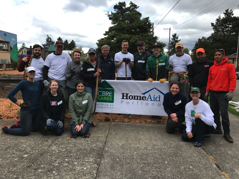 SUBMITTED: CBRE - About 15 Portland-based CBRE employees participated in the Build Day, which provided a new deck and garden area for the Hope House.