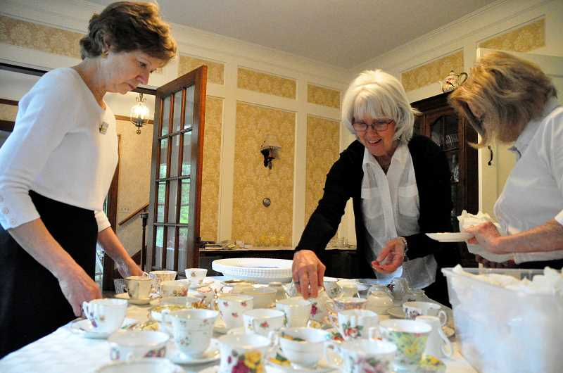 STAFF PHOTOS: LESLIE PUGMIRE HOLE - Saucers and cups are carefully wrapped separately for storage; before the party, Sue Thalman, Marcia Daiker and Susy Calhoun match each with its mate.