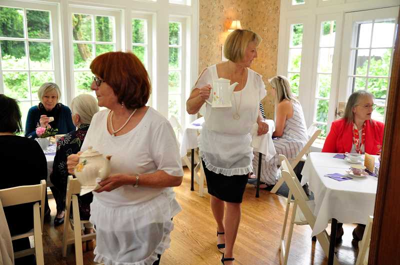 TIDINGS PHOTO: LESLIE PUGMIRE HOLE - Judi Meskel and Janet Brynelson serve tea at the Riverview Lions tea party June 3 at the historic McLean House.