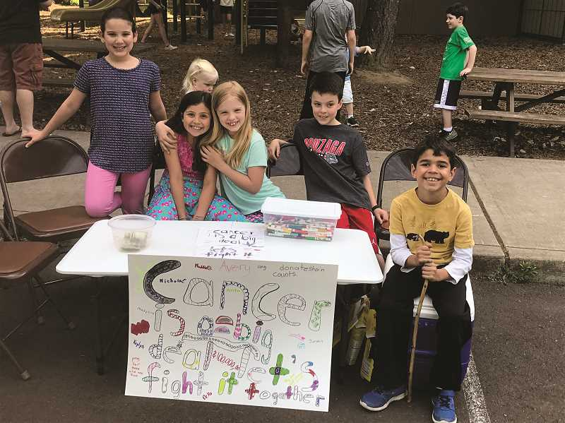COURTESY OF ST. FRANCIS CATHOLIC SCHOOL - An idea initiated by second-graders, who included (from left), Daniella Costa, Avery Contreras, Maddie Murphy, Nicholas Fisher and Preston Raleigh, was to collect money to fight cancer at St. Francis School's end-of-year barbecue