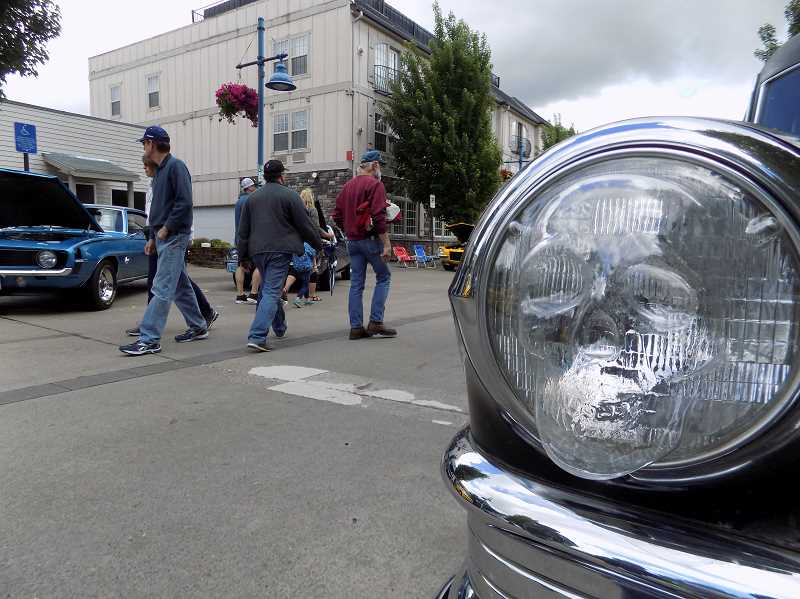 GAZETTE PHOTO: RAY PITZ - Yes, that is a skull headlight on Mike Ray's 1950 Cadillac hearse, which he brought to show off at the June 10 Cruisin' Sherwood event.