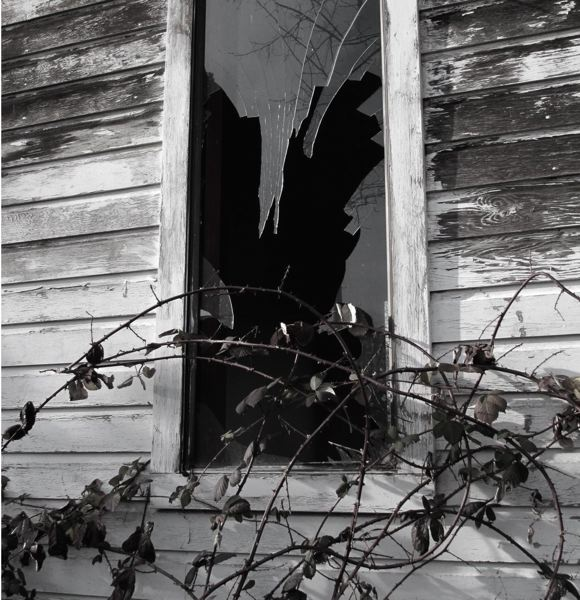 PHOTO COURTESY: OAK LODGE HISTORY DETECTIVES - This April shot of the south side of the 1975 addition to the original Philip T. Oatfield House (1903) painfully shows what years of neglect and abuse create. Were the original house to be moved, this addition would not make the trip but would be demolished first.