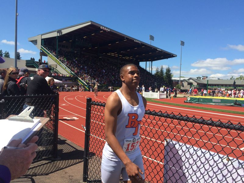TRIBUNE PHOTO: STEVE BRANDON - Micah Williams, a freshman at Benson High, leaves the track at Hayward Field after placing third in the Class 6A 100-meter dash last month.