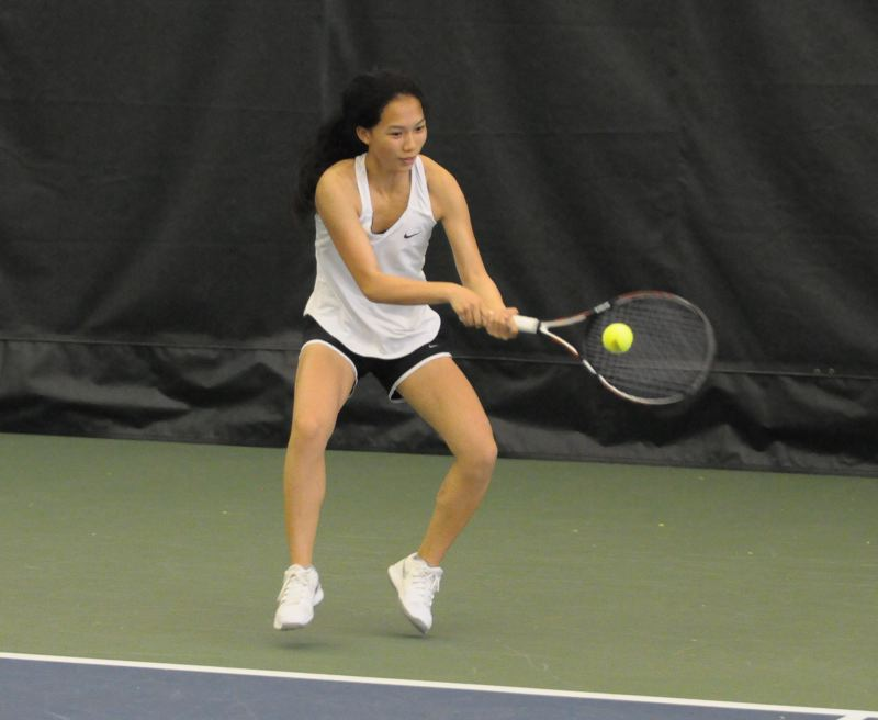 PAMPLIN MEDIA GROUP: SETH GORDON - Haiying Kuang of Cleveland High competes in this year's Class 6A tournament.
