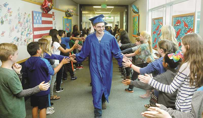 GARY ALLEN - Dozens of soon-to-be Newberg High School graduatestraveled to the elementary and middle schools they attended as youthsduring the first-ever Grad Walk Thursday in Newberg. They were enthusiastically received.