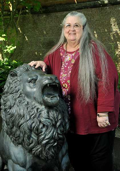 Standing by WLHS lion mascot, Sheree Little is looking forward to retirement after many years serving schools.