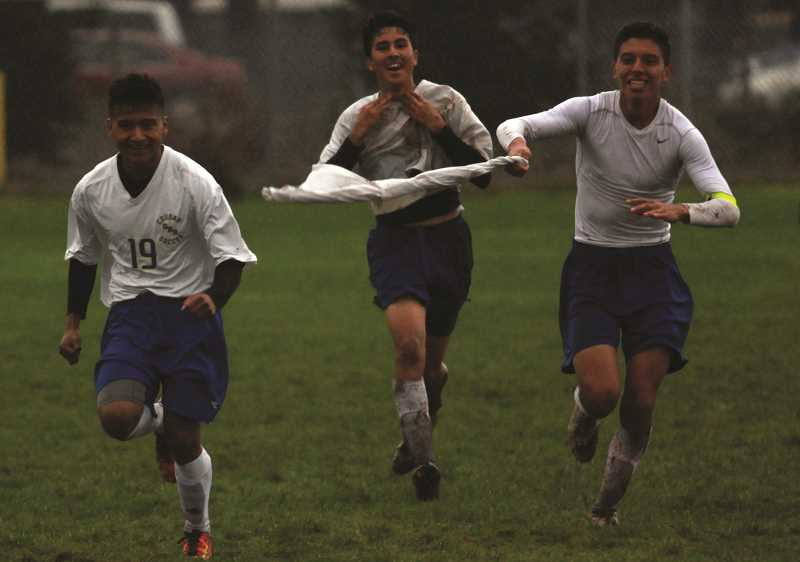 PHIL HAWKINS - Gervais' Pedro Hernandez, Jafeth Casas and Alejandro Isiordia celebrate moments after clinching the conference title for the boys soccer program in November.
