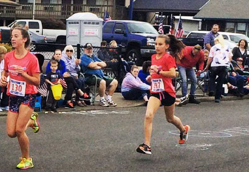 PHOTO BY RHONDA RAE - Molalla River Middle School eighth grader Holly Rae (right) runs in last year's Freedom 5k during the annual Independence Day celebrations in