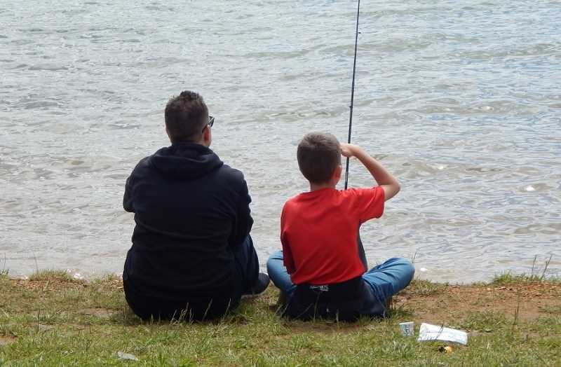 BARBARA SHERMAN - Sharing a father-and-son moment fishing at Hagg Lake are dad Brian, who went along on the LRMS survival class field trip to spend time with his son Jake.
