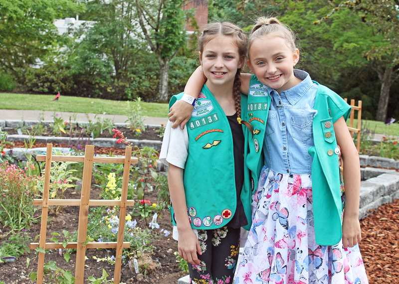 REVIEW PHOTO: JILLIAN DALEY - Oak Creek Elementary fourth-grader Melanie Gabriel Hastings (right) and her friend, fourth-grader Makayla McCartney-Pike, both Girl Scouts, created a butterfly garden at their school.