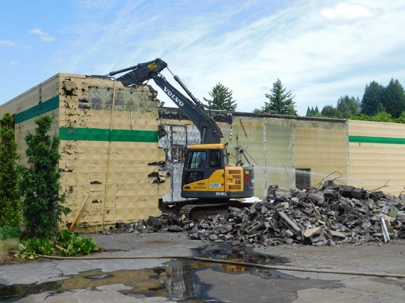 ESTACADA NEWS PHOTO: EMILY LINDSTRAND - Demolition on the former Safari Club building began several weeks ago. Here, one of the buildings walls is torn down.