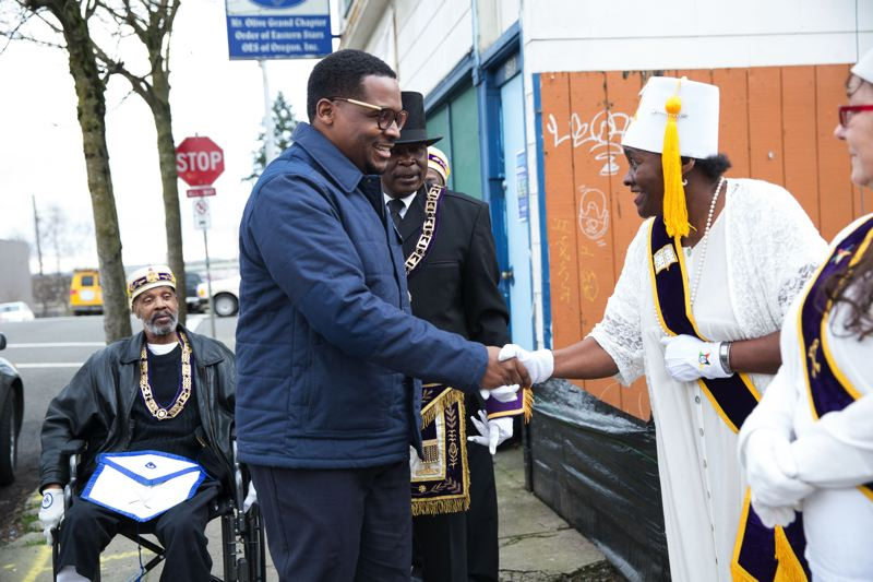 PAMPLIN MEDIA GROUP FILE PHOTO - Prosper Portlands manager of entrepreneurship and community economic development Tory Campbell brings a $40,000 grant to the Sons of Haiti Most Worshipful  St. Josephs Grand Lodge last year.