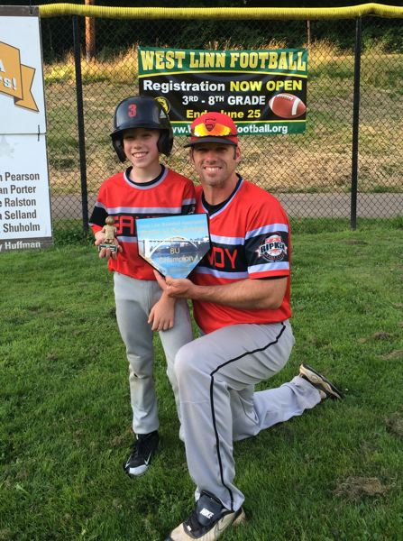 CONTRIBUTED PHOTO - Garet Luebbert enjoys time playing and coaching baseball on Father's Day.