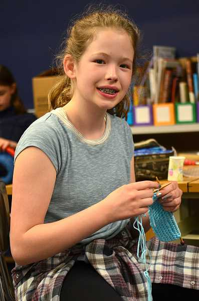 REVIEW PHOTO: VERN UYETAKE - The Lake Oswego Junior High School Knitting Club, led by sixth-grader Annelise Foster, is helping babies in need with its volunteer efforts.