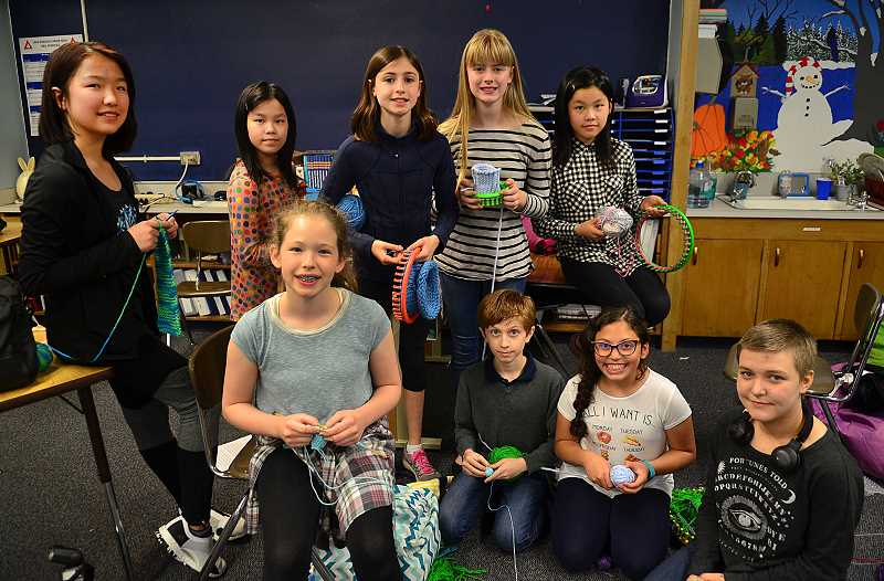 REVIEW PHOTO: VERN UYETAKE - Lake Oswego Junior High School just got a new Knitting Club this fall, and the group has been active in using their talents with weaving yarn to help others. From left: front row, Annelise Foster, Thomas Preston, Yadriana Rivera, Taryn Jones; and back row, Camille Wang, Clio Koh, Grace Wollmuth, Isabelle Goodrich and Eileen Koh.